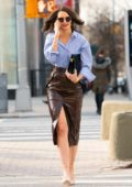Katie Holmes looks stylish in a blue shirt and brown leather slit skirt as she steps out in New York City