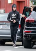 Katy Perry spotted in her black Adidas hoodie and leggings while out getting some dinner to-go at Larchmont Village in Los Angeles