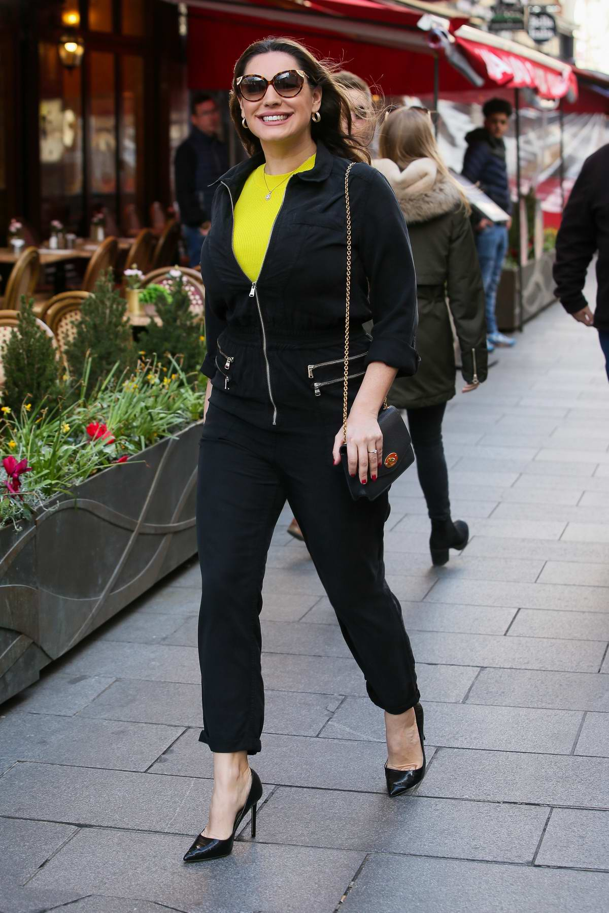 Kelly Brook dons an all black jumpsuit as she arrives at Global Radio studios in London, UK