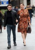 Kelly Brook looks lovely in animal print as she arrives at Global Radio with boyfriend Jeremy Parisi in London, UK