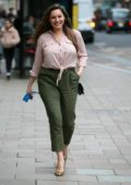 Kelly Brook looks pretty in a pink shirt as she arrives at Global Radio studios in London, UK