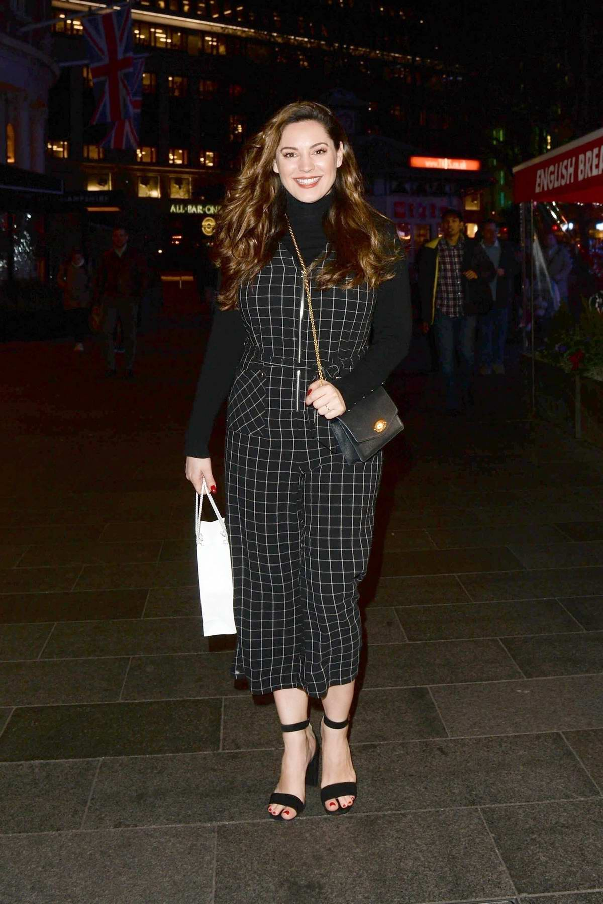 Kelly Brook seen wearing a black checkered outfit as she leaves Global Radio studios in London, UK