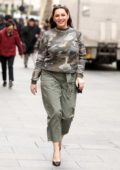 Kelly Brook wears a camo top with green khaki pants as she arrives at Global Radio studios in London, UK