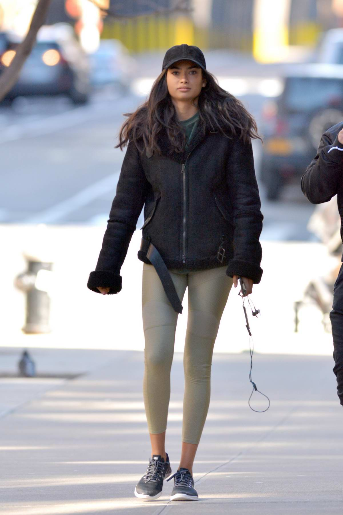 Kelly Gale spotted in a black jacket with gold leggings as she leaves a gym with her personal trainer in New York City