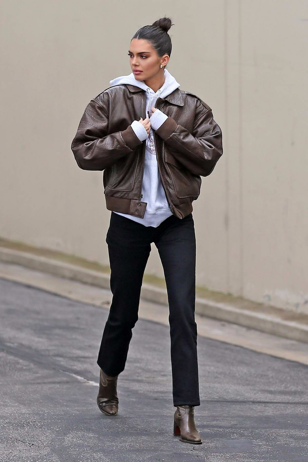 Kendall Jenner rocks a brown leather jacket paired with a