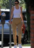 Kendall Jenner wears a white tank top and cargo pants while out to lunch with Fai Khadra in Hollywood, California