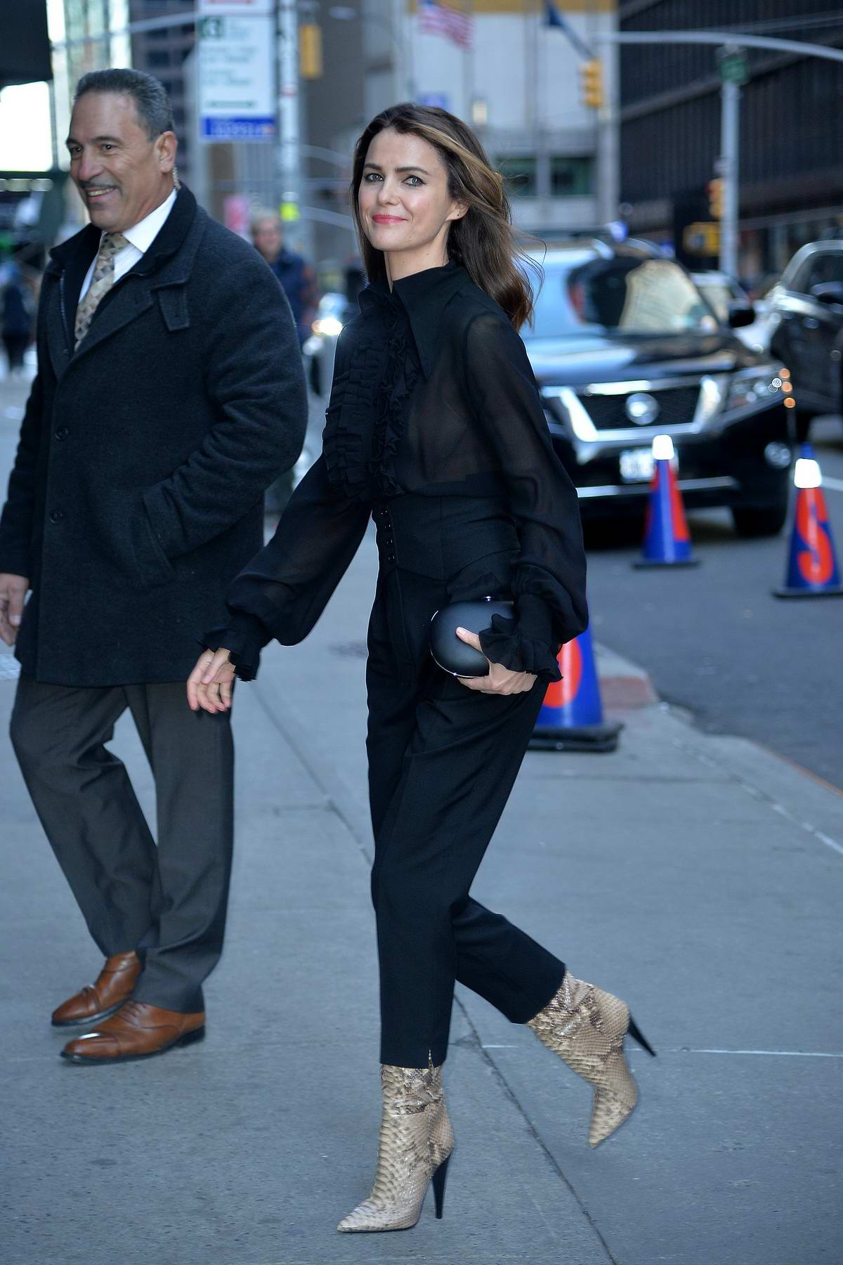 Keri Russell looks chic in all black as she arrives for an appearance on 'The Late Show with Stephen Colbert' in New York City