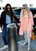 Kesha and boyfriend Brad Ashenfelter hold hands as they arrive at LAX Airport in Los Angeles