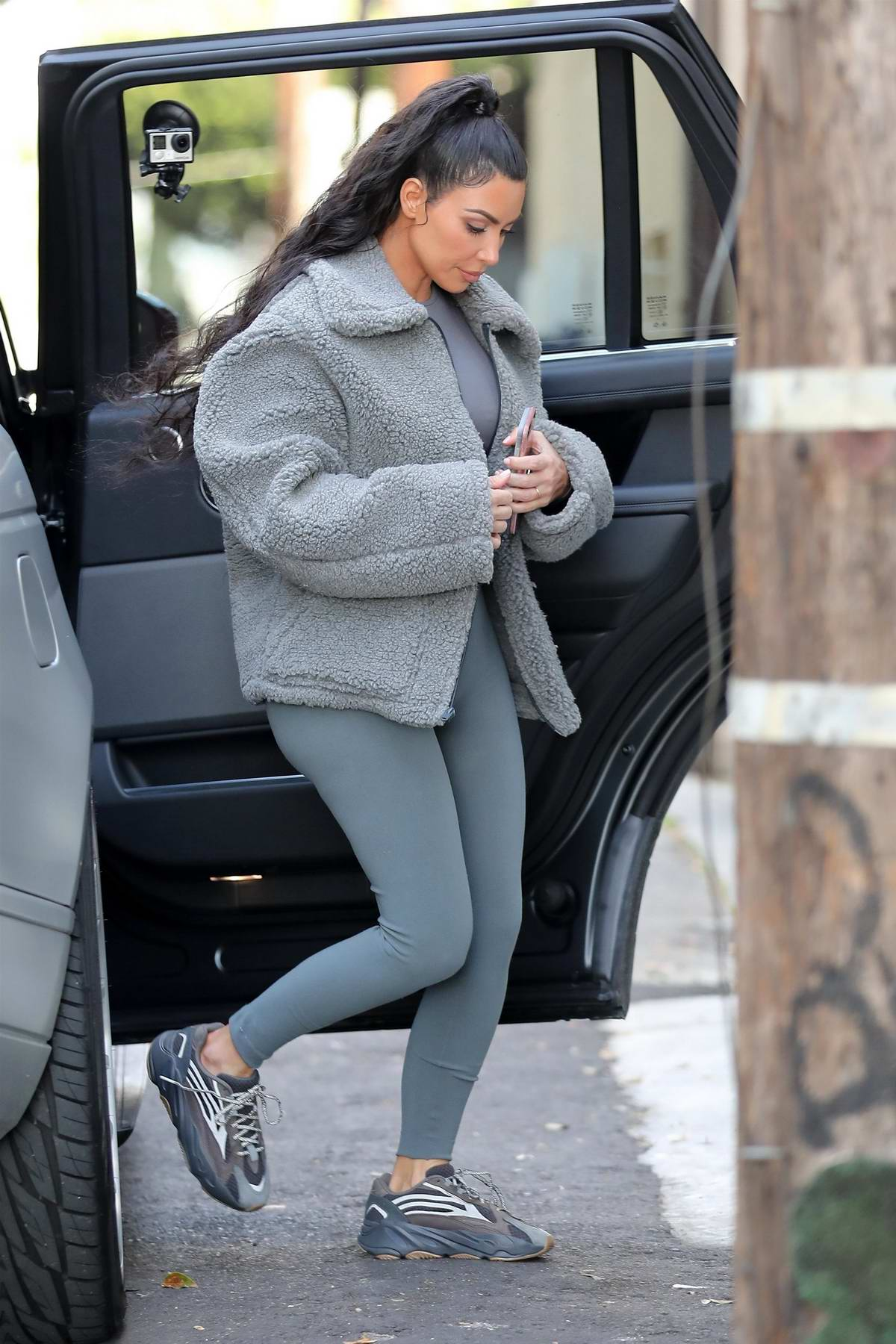 Kim Kardashian rocks an all grey ensemble as she steps out for dinner with Kourtney in West Hollywood, Los Angeles