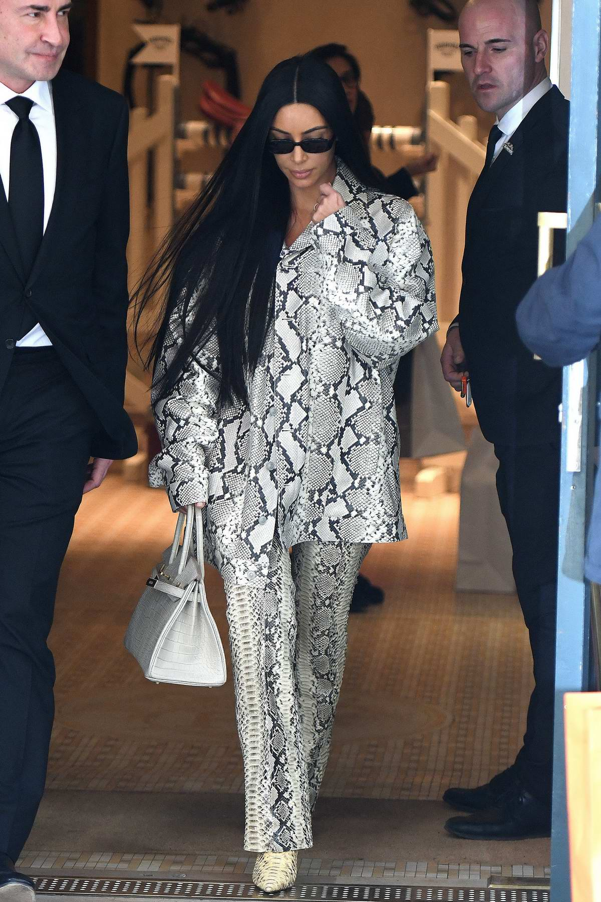 Kim Kardashian seen wearing snakeskin print ensemble as she leaves Hermes store in Paris, France