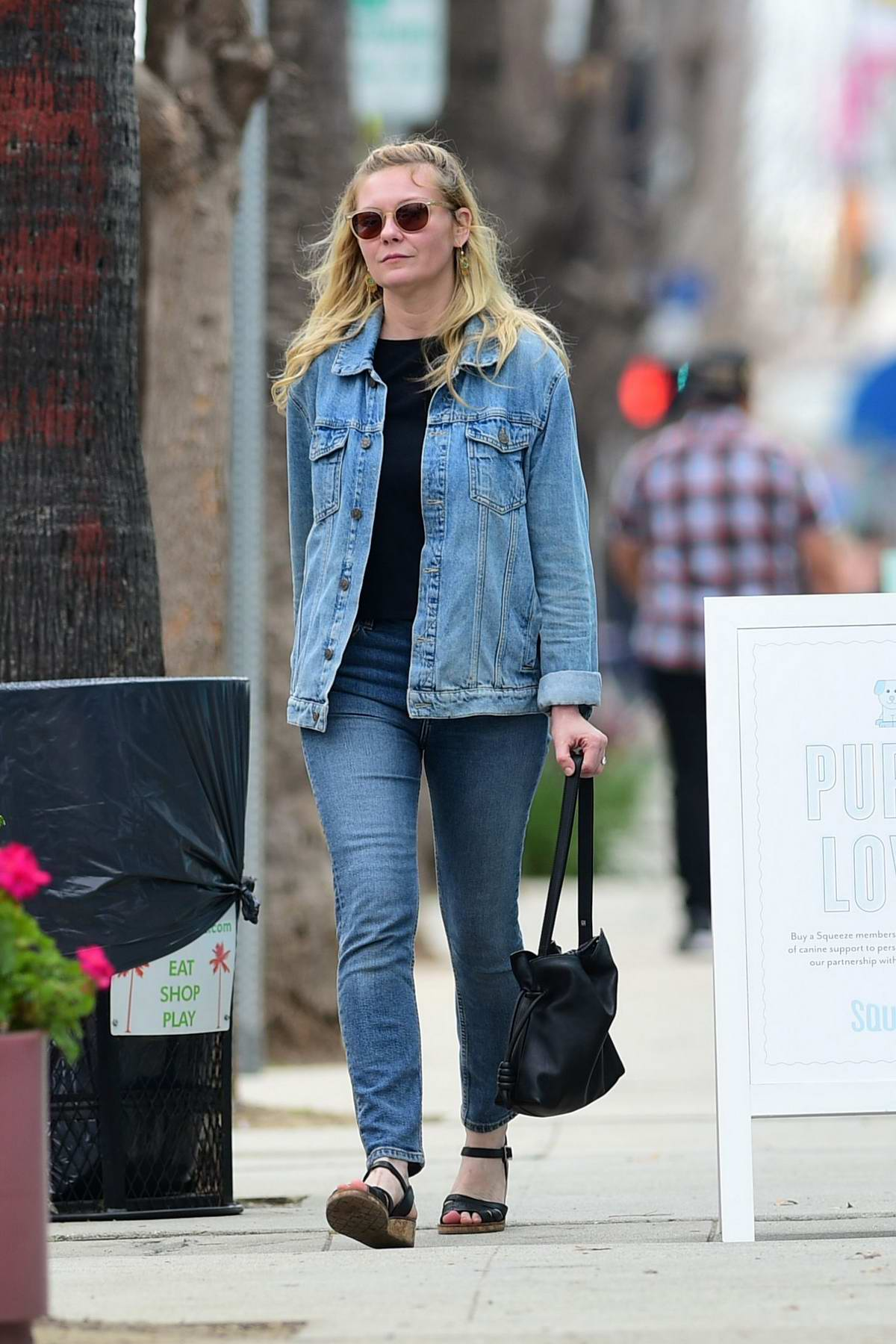 Kirsten Dunst dons double denim as she run errands before grabbing lunch at Joan's on Third in Los Angeles