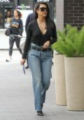 Kourtney Kardashian slips into plunging black top for errands in Woodland Hills, California