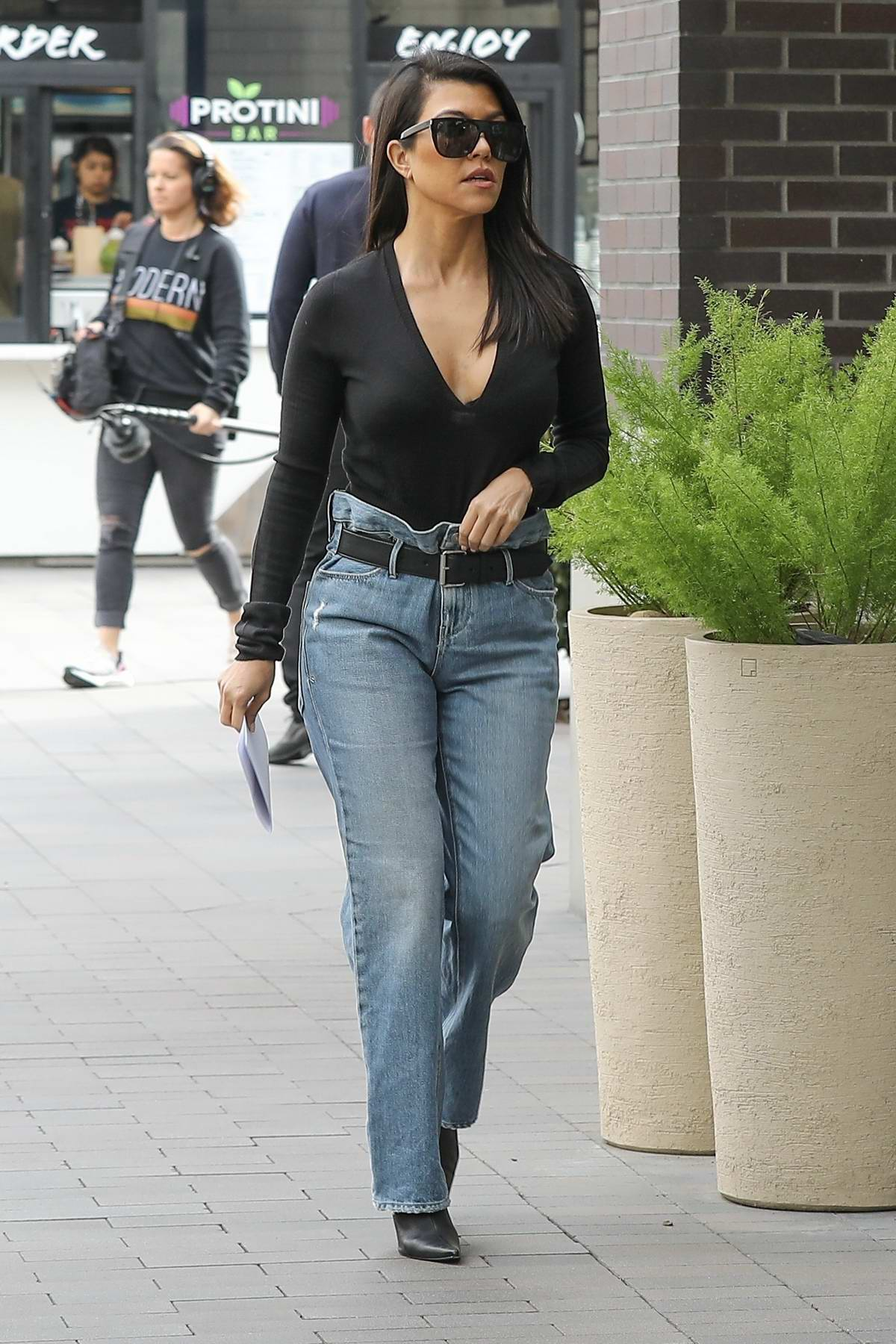 Kourtney Kardashian Slips Into Plunging Black Top For Errands In Woodland Hills California