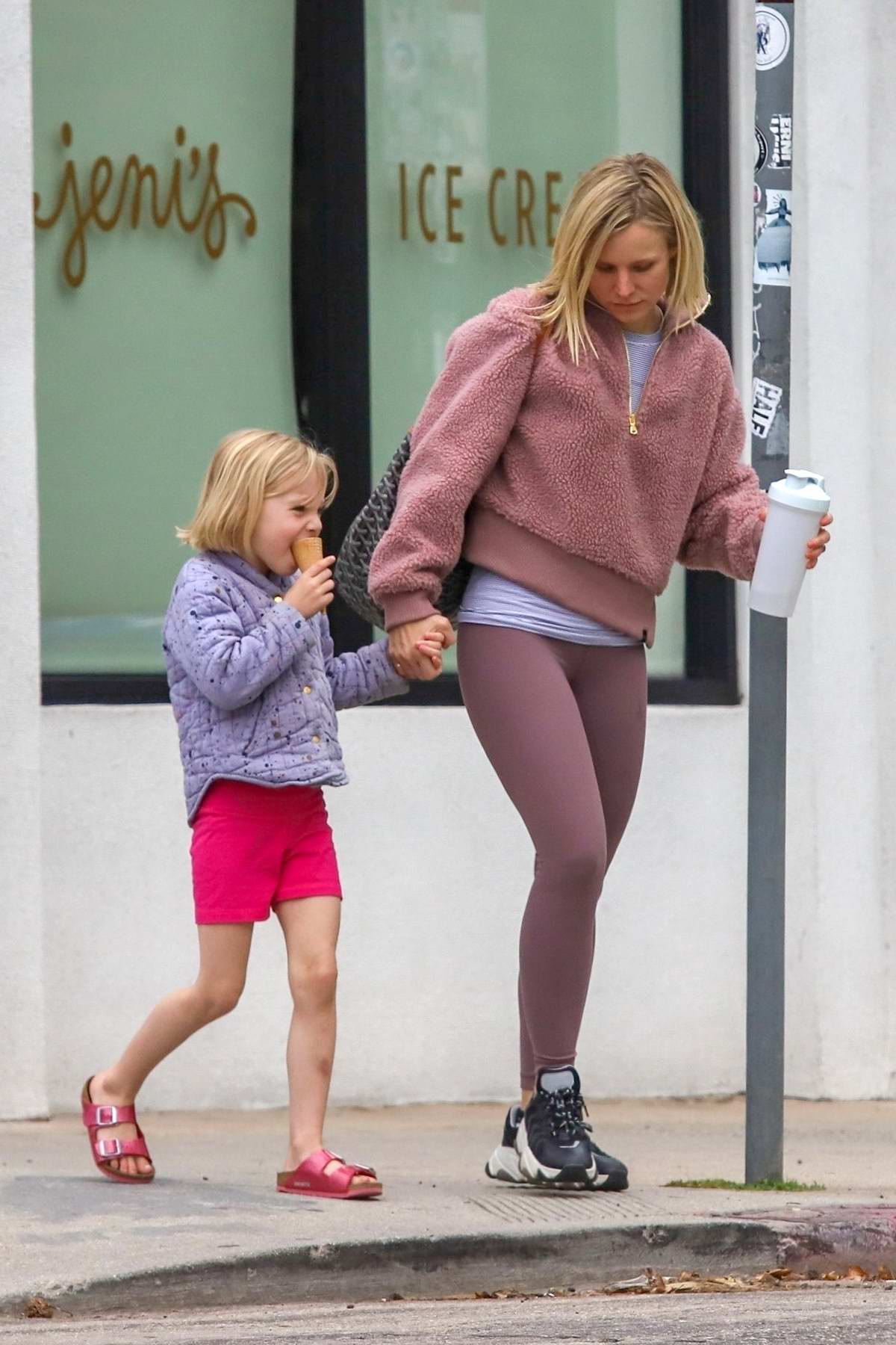 Kristen Bell sports a mauve jacket with matching leggings as she leaves a pilates session with her daughter in Los Angeles