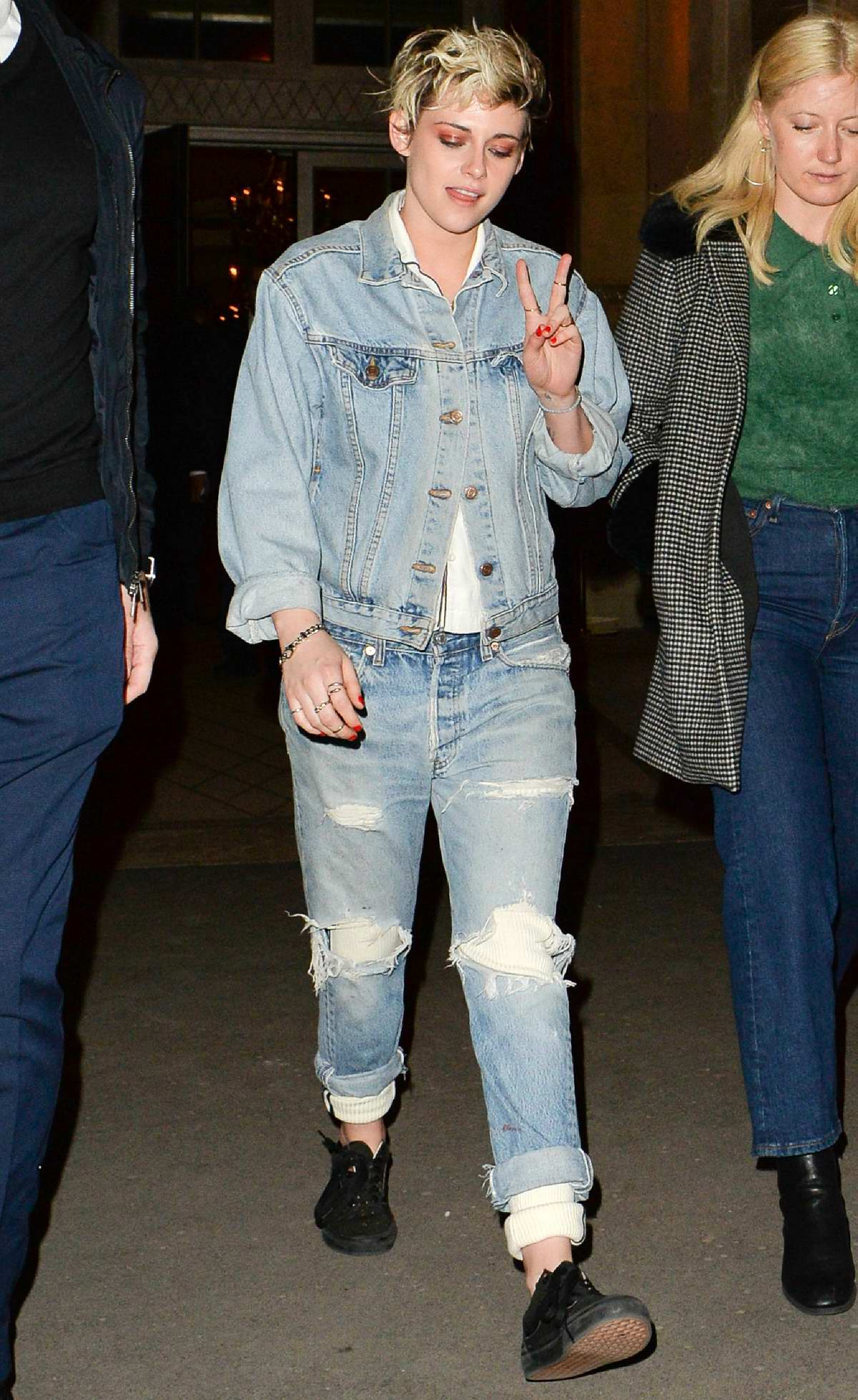 Kristen Stewart flashes peach sign as she leaves the Louis Vuitton after party during Paris Fashion Week 2019 in Paris, France