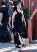 Krysten Ritter wears a black maxi dress while out with boyfriend Adam Granduciel and her dog in Los Angeles
