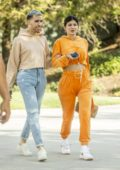 Kylie Jenner stands out in bright orange while out for lunch with a friend at Sugar Fish in Calabasas, California
