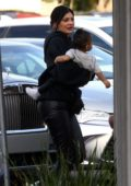 Kylie Jenner takes her daughter to a birthday party in Encino, California