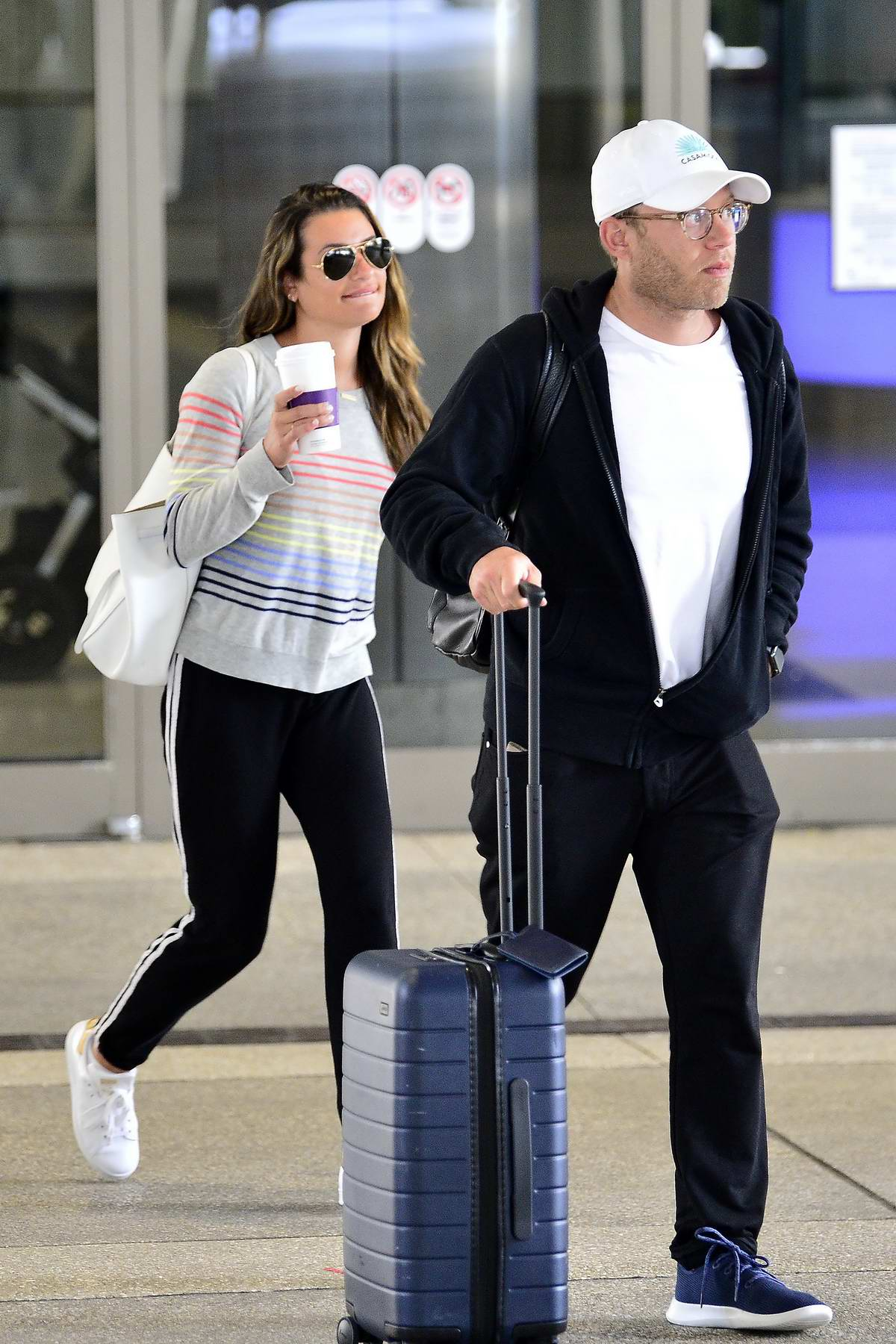 Lea Michele and Zandy Reich are spotted for the first time since their wedding as they arrive at LAX Airport in Los Angeles