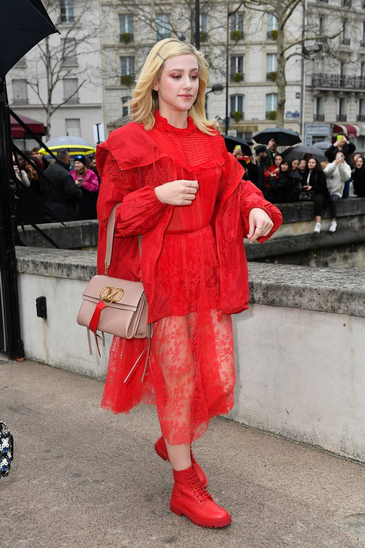 Lili Reinhart dazzles in a bright red ensemble as she attends the Valentino show during Paris Fashion Week F/W 2019/20 in Paris, France