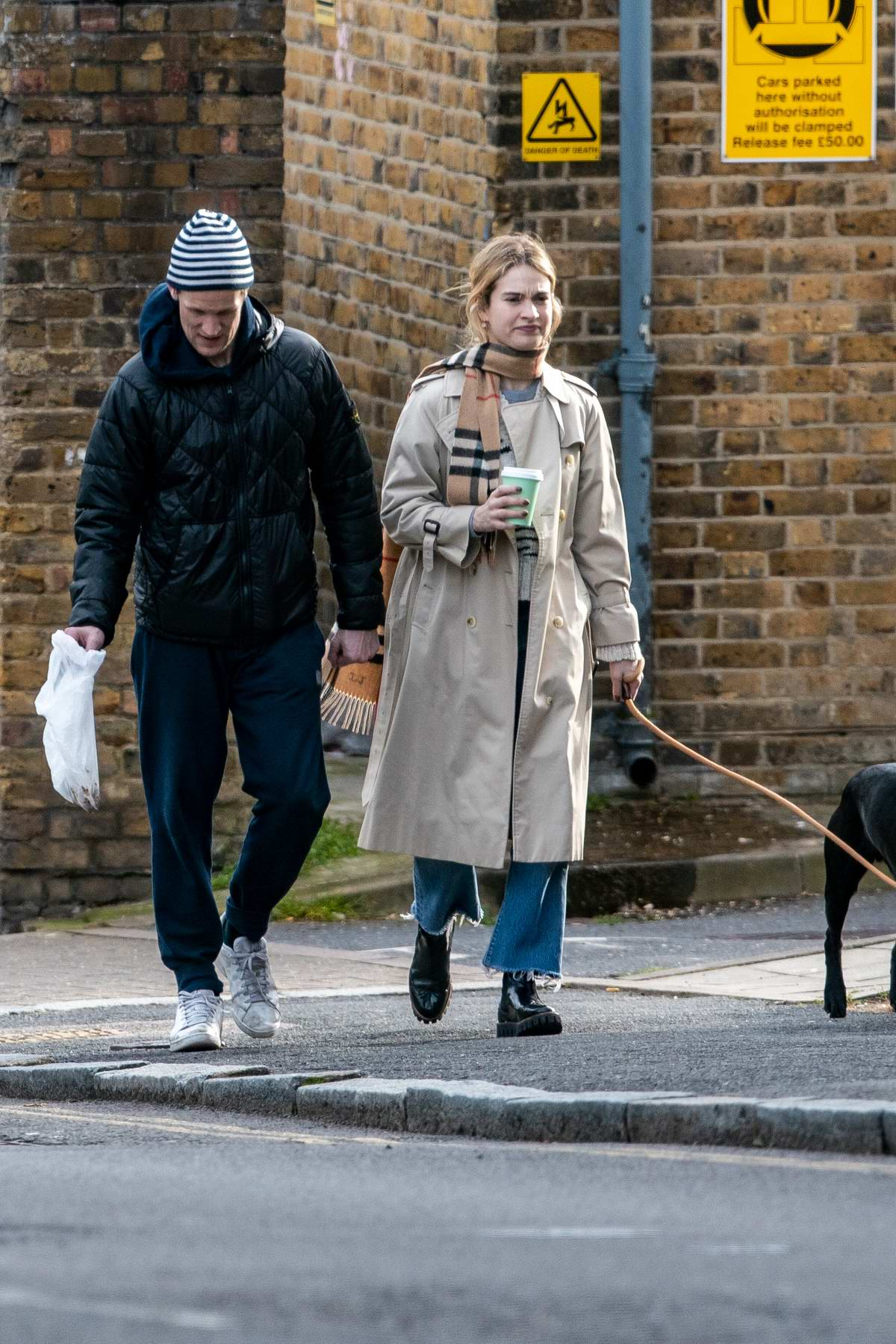 Lily James and Matt Smith enjoys a stroll while walking their dog in Hampstead Heath, London, UK