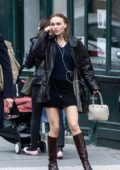 Lily-Rose Depp spotted in a short black dress with black leather jacket and knee high brown boots while out in Paris, France