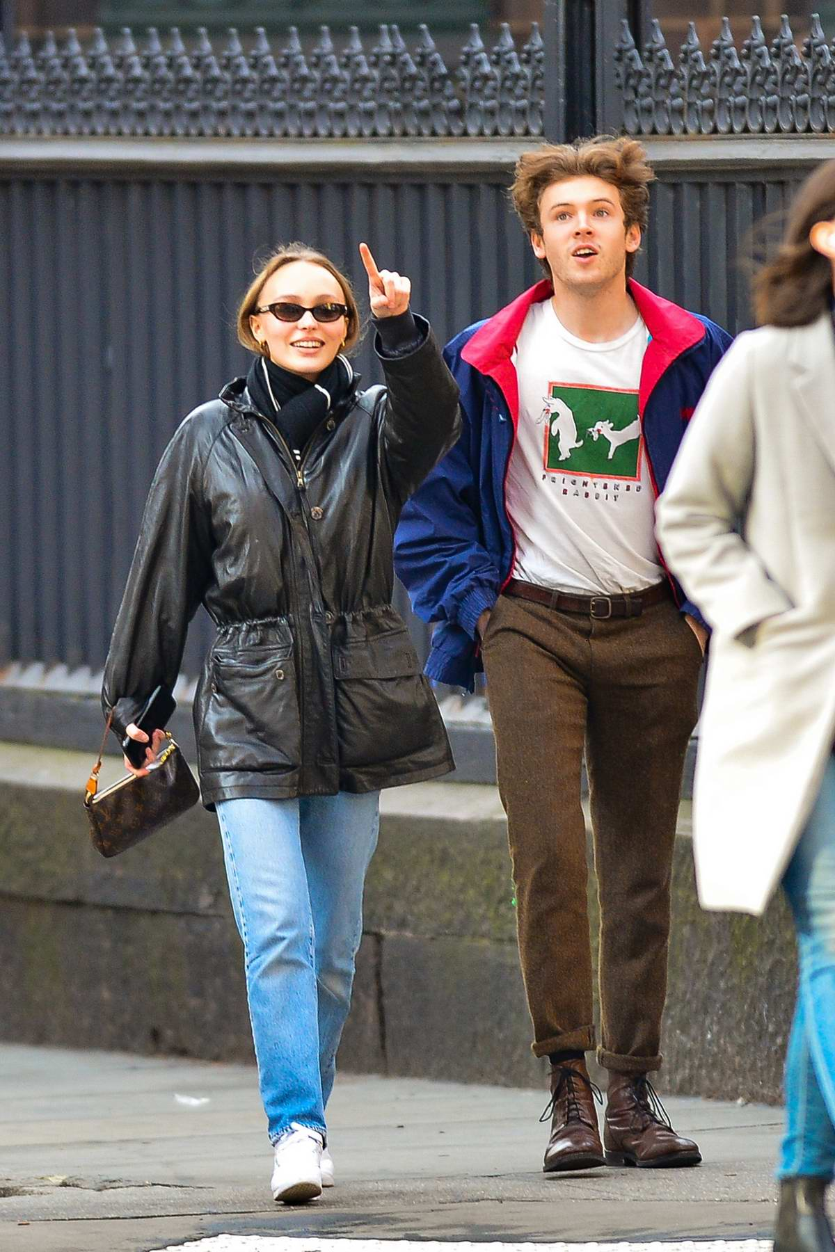 Lily-Rose Depp steps out for a stroll with a male friend in New York City