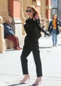 Lindsay Lohan strike a pose for the camera while out in New York City