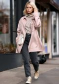 Lottie Moss wears a pastel pink coat while out shopping on Kings Road in London, UK