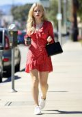 Lottie Moss wears a red dress while out in West Hollywood, Los Angeles