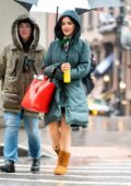 Lucy Hale braves the rain with a green parka and UGG boots while on set for Riverdale spinoff 'Katy Kenee' in New York City