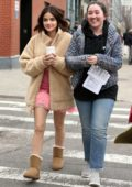 Lucy Hale keeps warm with a beige sherpa jacket and a cup of coffee while on set of 'Katy Keene' in New York City