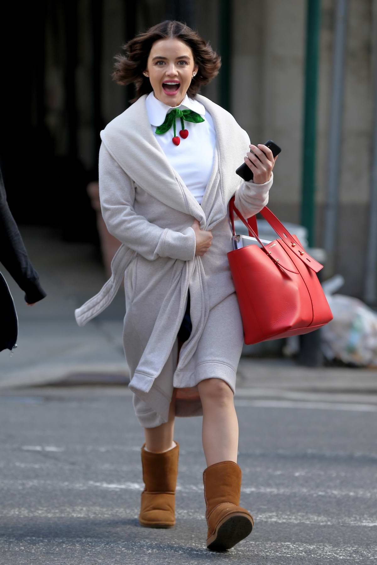Lucy Hale looks cute in a white top and blue skirt while filming Riverdale spinoff 'Katy Kenee' in New York City