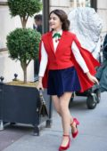 Lucy Hale looks festive in a red cape blazer, a blue mini skirt and red pumps while filming Riverdale spinoff 'Katy Keene' in New York City