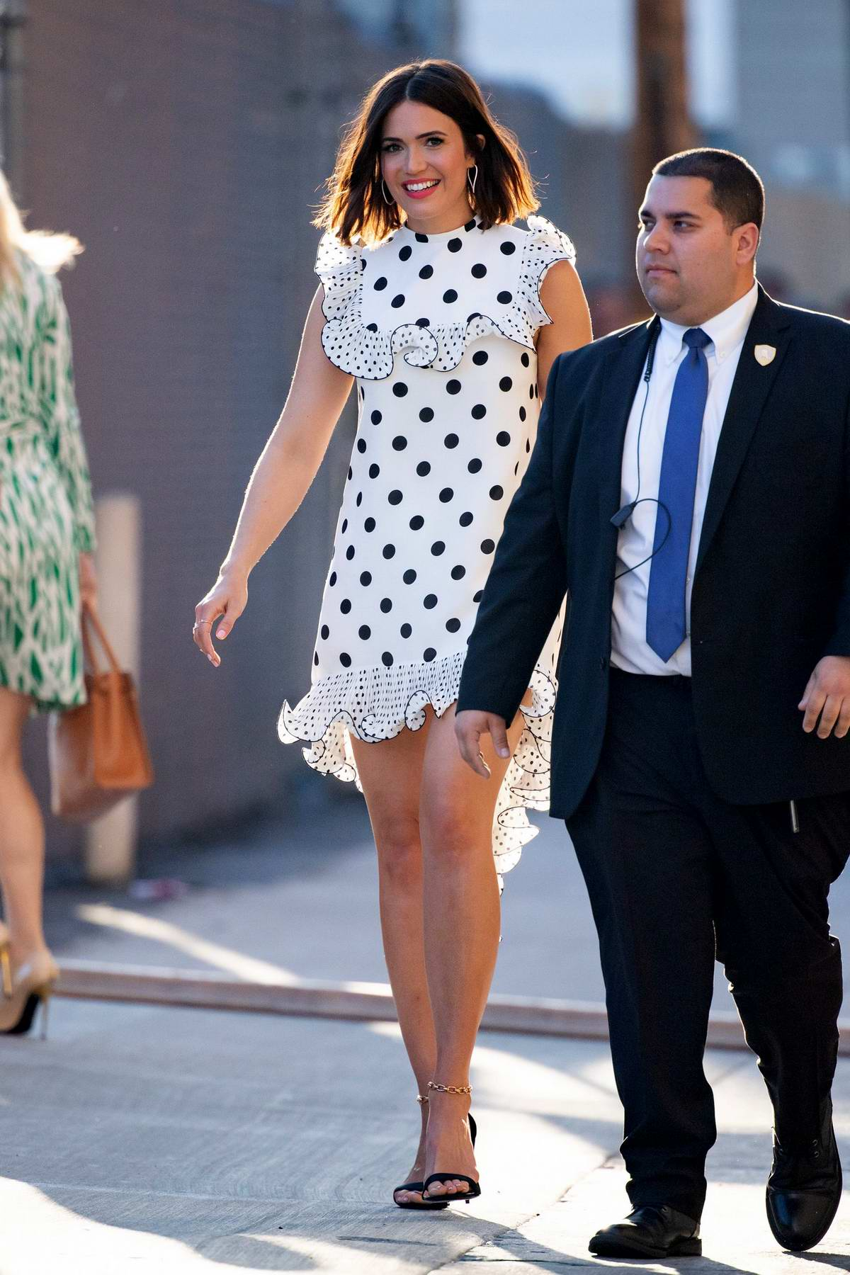 Mandy Moore looks pretty in a white polka dots dress as she arrives for her appearance on Jimmy Kimmel Live! in Hollywood, Los Angeles