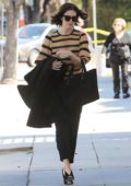 Mandy Moore steps out in a striped knitted sweater and black trousers in Beverly Hills, Los Angeles