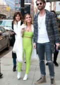 Maren Morris spotted in a lime green jumpsuit with a white fur coat while out in New York City