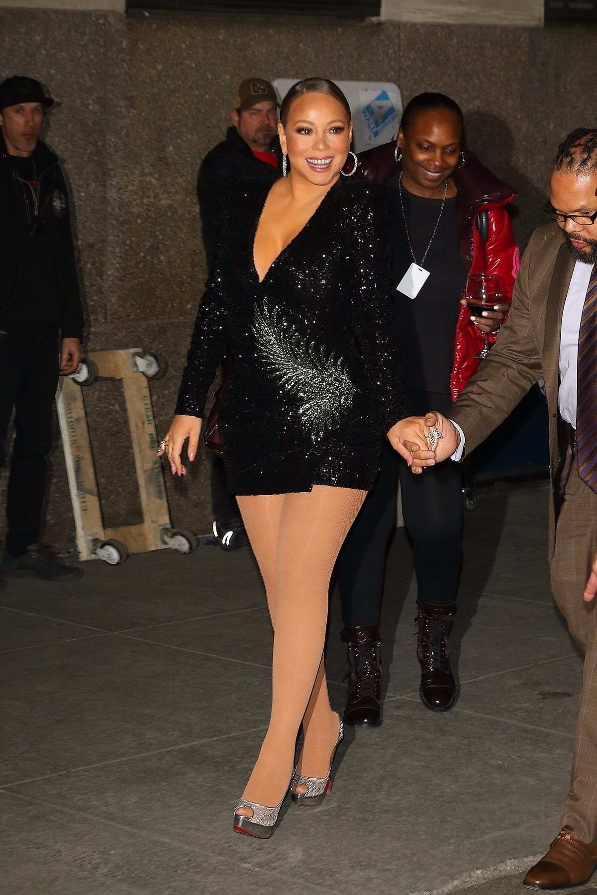 Mariah Carey dons a black mini dress as she leaves Radio City Music Hall in New York City