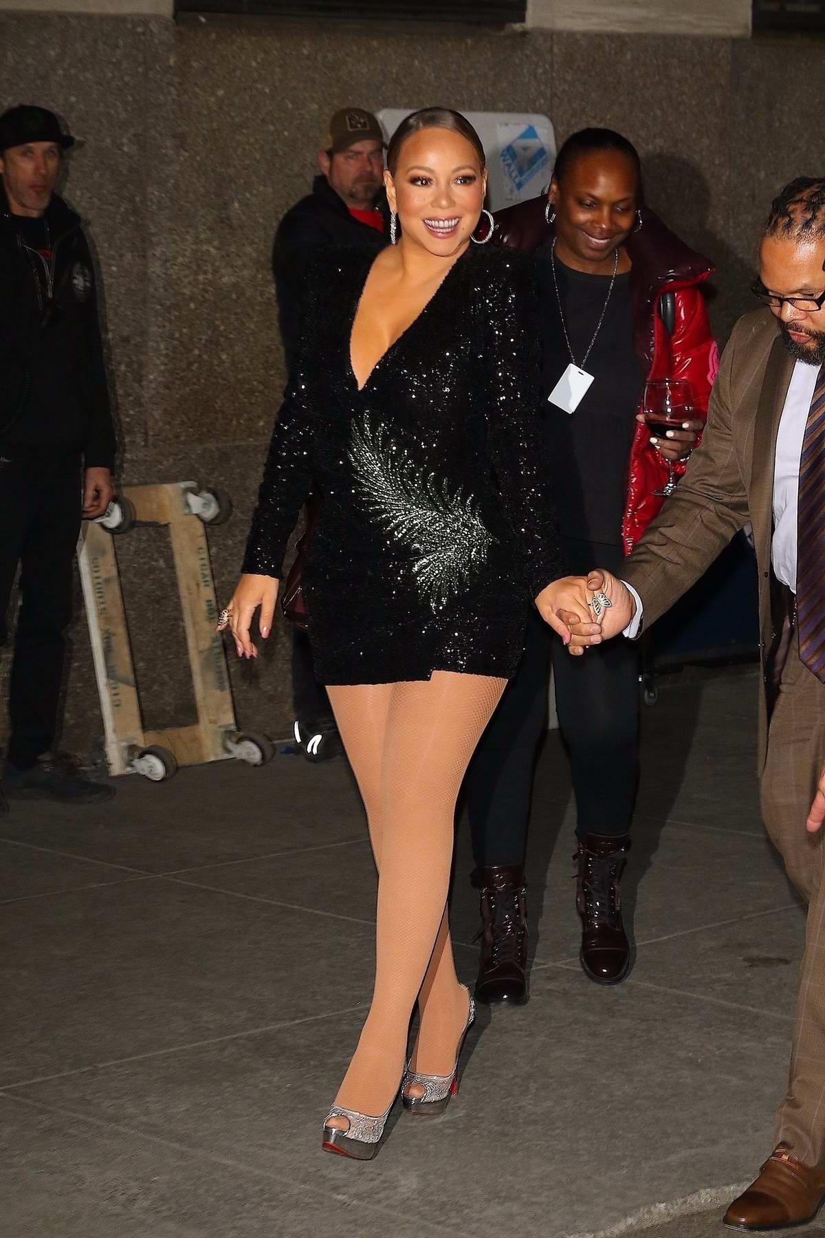 Mariah Carey dons a black mini dress as she leaves Radio City Music Hall in New York City