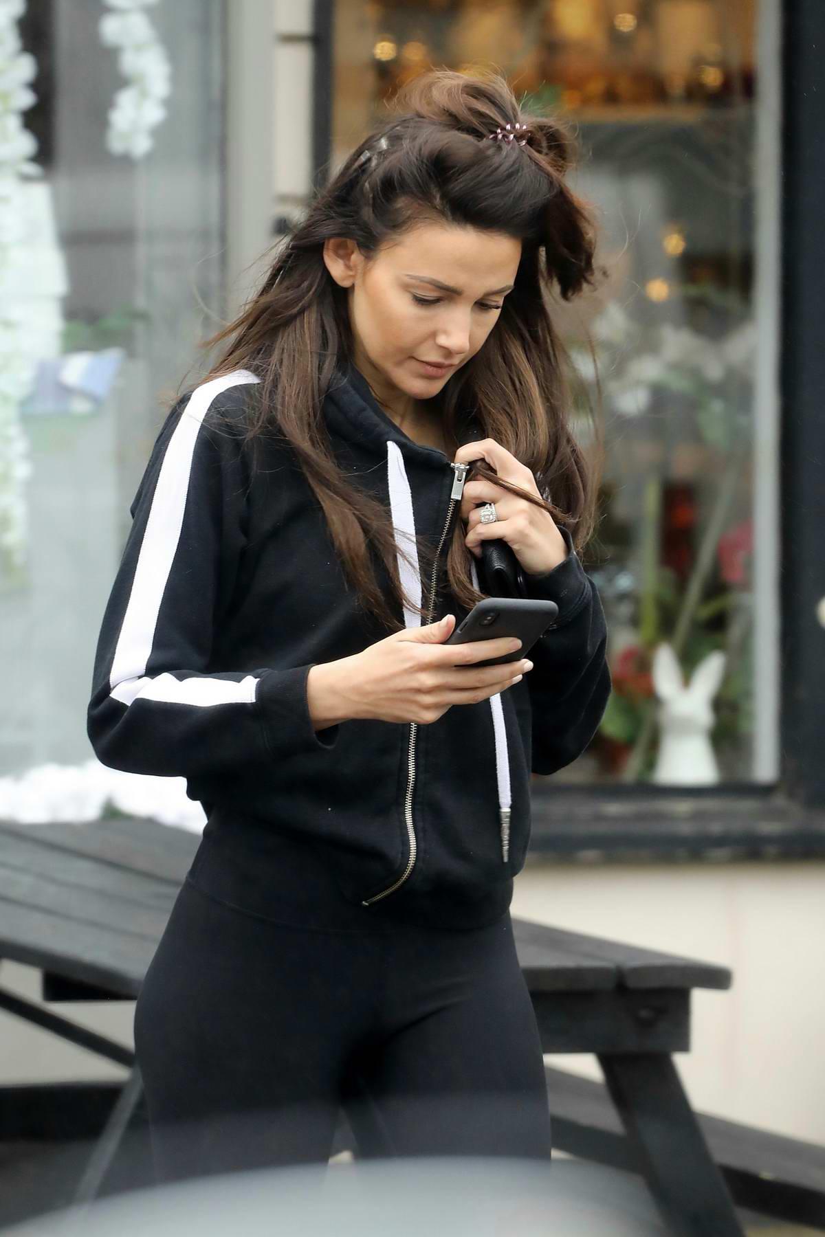 Michelle Keegan steps out in a black hoodie and leggings in Brentwood, Essex, UK