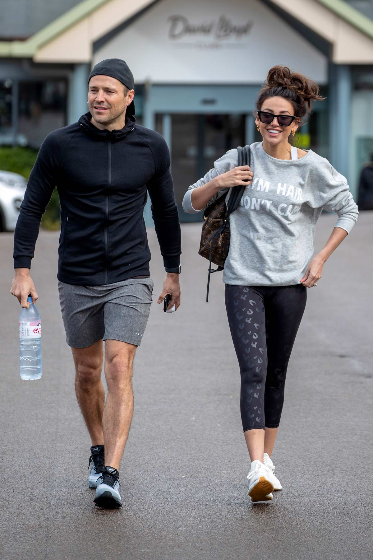 Michelle Keegan wears 'Gym Hair Don't Care' sweatshirt and leggings while heading to the Gym with Mark Wright in Essex, UK