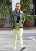 Mila Kunis looks ready for Spring in green while out with a friend in Los Angeles