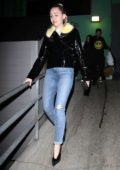 Miley Cyrus sports a fur-lined black leather jacket during a night out at TomTom Bar in West Hollywood, Los Angeles
