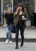 Milla Jovovich chats on her phone during a coffee run in Los Angeles