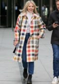 Mollie King is all smiles as she leaves the BBC Radio 1 studios in a colorful plaid coat in London, UK