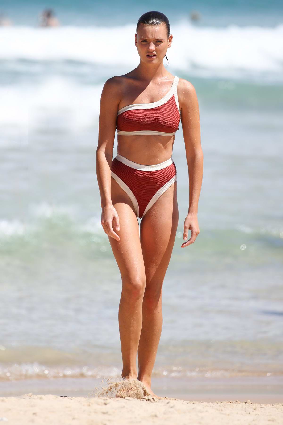 Montana Cox wears a red and white bikini while on Bondi Beach in Sydney, Australia