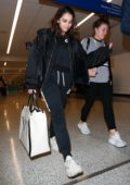 Naomi Scott keeps it casual as she arrives to catch a flight out of LAX Airport in Los Angeles