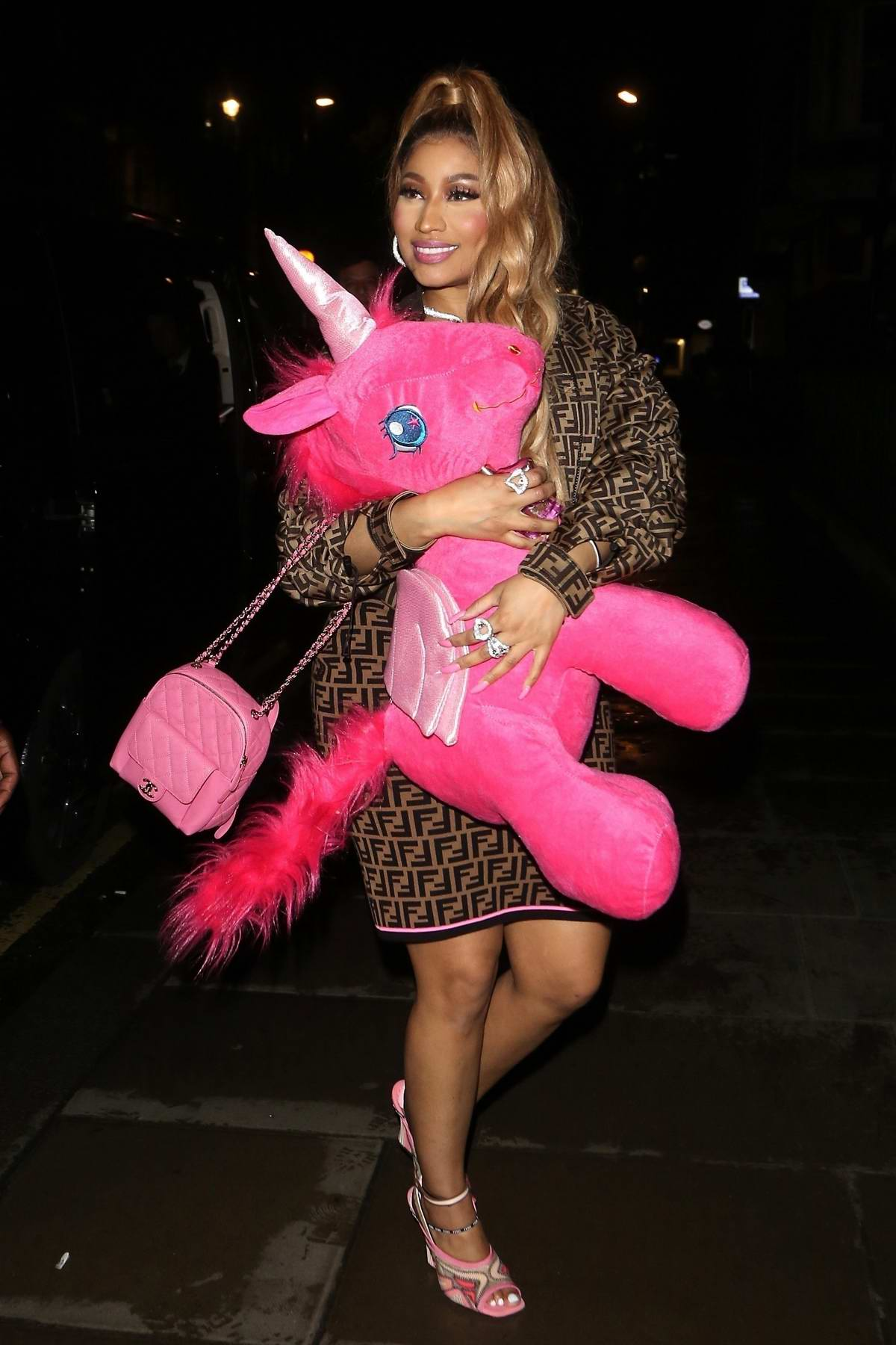 Nicki Minaj rocks a Fendi dress and a pink unicorn as she leaves Opium nightclub in London, UK