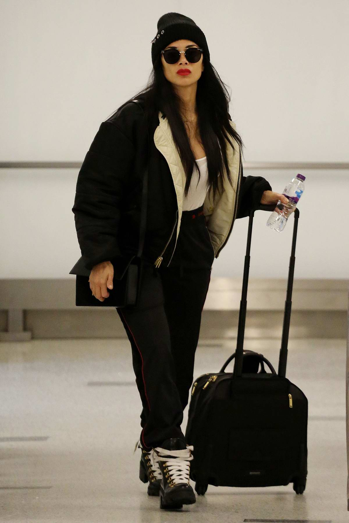 Nicole Scherzinger sports all black as she jets into LAX airport in Los Angeles