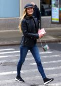 Nina Agdal keeps it trendy with a hat, black leather jacket and blue jeans while out in New York City